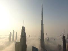 Aerial view of Burj Khalifa downtown Dubai at sunrise. Stock Footage