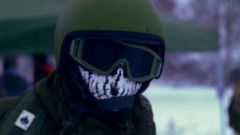 Military man in helmet and skeleton Balaclava Stock Footage