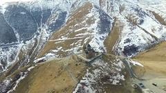 Gergeti among the mountains in Georgia, topview Stock Footage