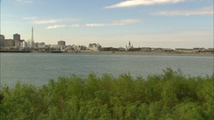 Pan to New Orleans skyline on Mississippi River Stock Footage
