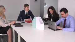 Young businessmen businesswomen boardroom, sales strategy planning, team work 4K Stock Footage