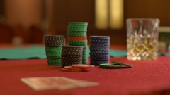 Woman looks at cards poker table Stock Footage