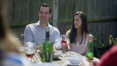 4K Couple socializing with friends, with lunch & drinks outdoors on a summer day Stock Footage