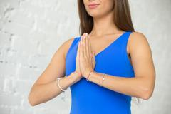 Close up of a young attractive woman making the Namaste Stock Photos