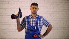Construction worker with screwdriver.  Man with power tools. Stock Footage