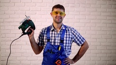 Man with an electric jig saw.  Working with electric jig saw. Stock Footage