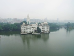 White ancient palace on sland in  middle of pond in city park Stock Footage