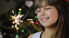 Happy Girl With a Sparkler In Their Hands Stock Footage