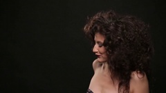 Young brunette with long brown curly hair dancing Stock Footage