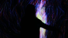 Girl play with interactive video installation Stock Footage