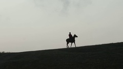 Cossack on horseback galloping over the hill Stock Footage