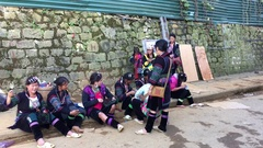 Hmong women wait to guide tourists, Sa Pa, Vietnam Stock Footage