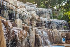 Artificial waterfall in the park of mineral springs Stock Photos