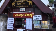 Currency exchange booth in Luang Prabang, Laos Stock Footage