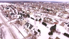 Stunning aerial view of upper class neighborhood under January snow Stock Footage
