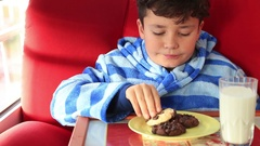Child eating a chocolate chip cookie Stock Footage