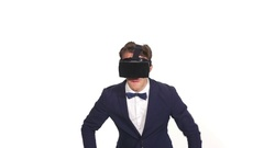 Young elegant man in a studio with white background playing a virtual reali.. Stock Footage