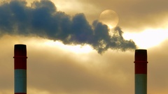 Beautiful sunrise through smokestack emissions in subzero Winter air Stock Footage