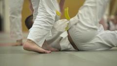 Judo class throwing Stock Footage