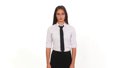 Businesswoman with serious expression adjusting her tie Stock Footage