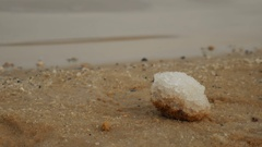 Close up of salt deposit on the sandy beach of the Dead Sea in Israel. Water Stock Footage