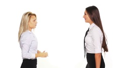 Two business women arguing and getting into a fight Stock Footage