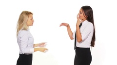 Two female colleagues talking when a male colleague with a smart phone pass.. Stock Footage