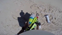 POV of a man getting ready to go kite surfing by unfolding and pumping up his ki Stock Footage