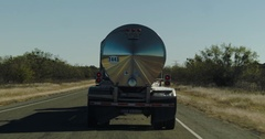 Passing a Tanker Semi Truck on a 2 Lane Highway in the Desert of Texas Stock Footage