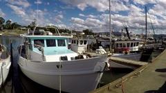 Fishing boats in Triabunna Marina on Tasmania's east coast in time lapse pan. Stock Footage