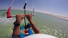 POV of a man doing a 360 spinning trick while kite surfing in the Red Sea, Egypt Stock Footage