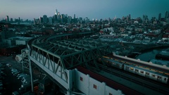 Aerial dusk view flying behind subway towards New York City Arkistovideo