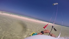POV of a man doing a trick jumping over a sandbar while kite surfing in the Red Stock Footage
