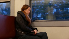 Tired woman travel at old suburban train at hard day evening Stock Footage