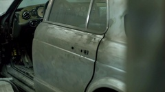 Car prepared for painting in paint shop Stock Footage