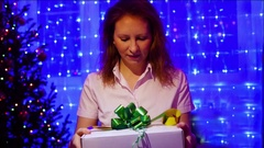 Christmas gift surprise - A girl opens present with magic stars. In the Stock Footage