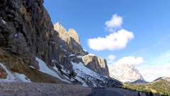 View from a speeding car on the winding roads in the mountains, Dolomites, Alps Stock Footage
