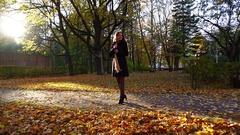 Slender woman feel happy, turn around in good spirits, nice autumn park Stock Footage