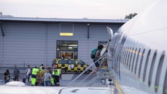 Passengers boarding a plane on the stairs in Berlin-Schonefeld Airport Stock Footage