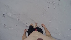 Male walking on pristine white sand of Hill Inlet Whitehaven beach Stock Footage