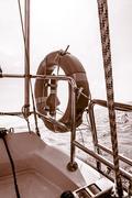 Rescue red lifebuoy life preserver saver ring on sailboat Stock Photos
