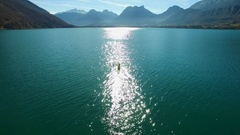 A kayaker paddles in a scenic mountain lake. Stock Footage