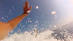 Surfers giving a high-five greeting while surfing, slow motion. Stock Footage