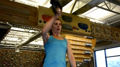 Kettlebell snatches by athletic woman Stock Footage