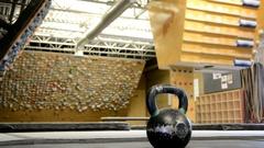 Kettlebell heavy swings by athletic woman. Stock Footage