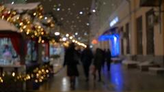 People walking on the street in the evening, a festive illumination, out of Stock Footage