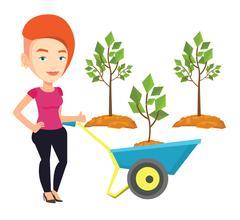 Woman pushing wheelbarrow with plant Stock Illustration