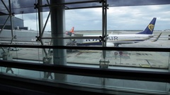 Tracking shot of the runaway from inside the building. At Barcelona airport. Stock Footage