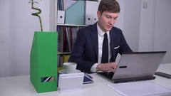 Corporate office male manager stop working on laptop smiling to camera trustful Stock Footage