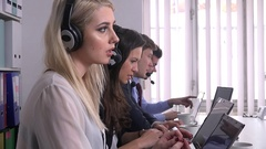People working in call center business teamwork busy operator talk customer care Stock Footage